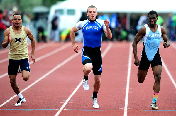 "Harrison Einspahr, center, of Broomfield,  runs to a first place finish in the  4A boys 100 dash during the last day of the 2012 Colorado High School State Track & Field Championships at Jefferson County Stadium. Photo by Paul Aiken / The Boulder Camera / may 19 2012<br /> Photo more photos go to  <a href=""http://www.dailycamera.com"">http://www.dailycamera.com</a>"