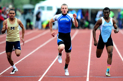 Harrison Einspahr, center, of Broomfield,  runs to a first place finish in the  4A boys 100 dash during the last day of the 2012 Colorado High School State Track & Field Championships at Jefferson County Stadium. Photo by Paul Aiken / The Boulder Camera / may 19 2012 Photo more photos go to www.dailycamera.com