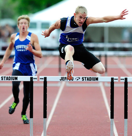 "Justin Boldt of Lyons runs to a second place finish in the 2A boys 300 hurdles,during the last day of the 2012 Colorado High School State Track & Field Championships at Jefferson County Stadium. Photo by Paul Aiken / The Boulder Camera / may 19 2012<br /> Photo more photos go to  <a href=""http://www.dailycamera.com"">http://www.dailycamera.com</a>"