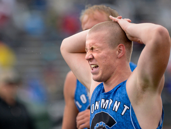 Longmont's DJ Fowler grimaces after his leg of the 4A boys 4x400 meter relay during the last day of the 2012 Colorado High School State Track and Field Championships at Jefferson County Stadium on Saturday, May 19, 2012.  Longmont finished third in the event.<br /> <br /> (Greg Lindstrom/Times-Call)