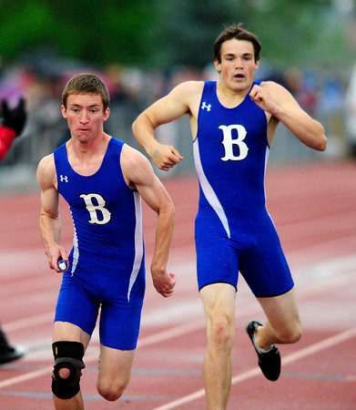 """Jake Morris passes the baton to Jack Reece of Broomfield for a 9th place finish in the 4A boys 4x400 relay during the last day of the 2012 Colorado High School State Track & Field Championships at Jefferson County Stadium. Photo by Paul Aiken / The Boulder Camera / may 19 2012<br /> Photo more photos go to  <a href=""""http://www.dailycamera.com"""">http://www.dailycamera.com</a>"""