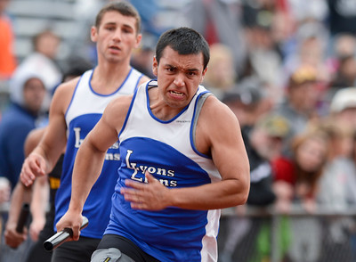 Lyons' Marcos Rodriguez takes the handoff from teammate River Crane during the 2A Boys 4x100 Meter Relay during the last day of the 2012 Colorado High School State Track and Field Championships at Jefferson County Stadium on Saturday, May 19, 2012.  Lyons finished first in the event.  (Greg Lindstrom/Times-Call)