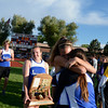 Lyons' Olivia Raspotnik, center, hugs teammate Dana Arling after the Lyons girls received their first place team trophy during the last day of the 2012 Colorado High School State Track and Field Championships at Jefferson County Stadium on Saturday, May 19, 2012.<br /> <br /> (Greg Lindstrom/Times-Call)