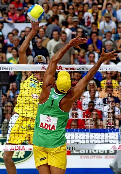 Emanuel Rego (Brazil) with Franco Neto (Brazil) attempting to block