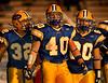 L-R Three seniors, #32  Steve Brancato. #40 Chris Bright, #80 Nick Russo, E. Meadow. Photo by Kathy Leistner