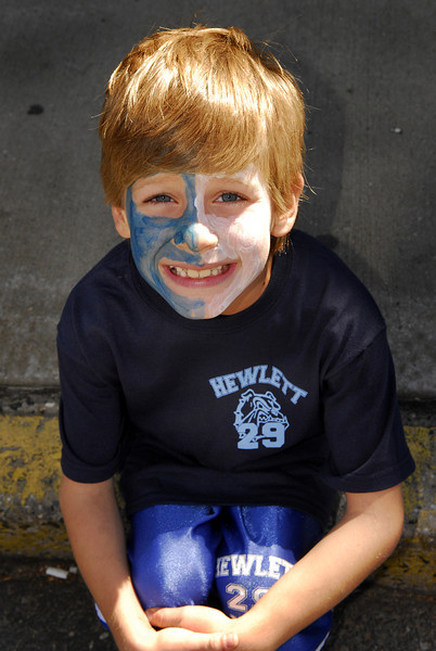 Ethan Grossman, 8,  waits for his sister a cheerleader for HHS on the curb of Broadway. .  Hewlett High School Homecoming Parade. September 29th, 2007. Photo by Kathy Leistner