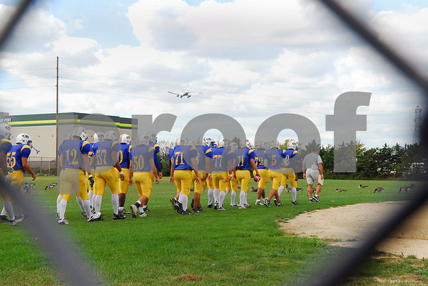Coach Lou Andre leads his team onto the football field. Lawrence HS Football vs Garden City, October 13th, 2007. 27-2. Photo by Kathy Leistner