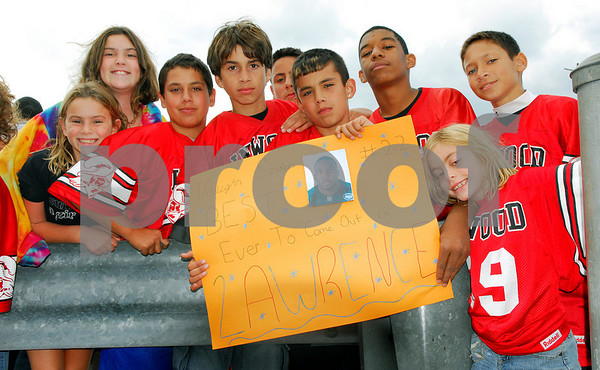 Inwood Buccaneers - 12 year olds coached by #22 Ron Sanders and their sign. Lawrence HS Football vs Garden City, October 13th, 2007. 27-2. Photo by Kathy Leistner