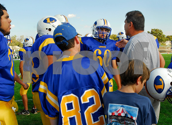 LHS #60 Joe McHugh listens to Coach Andre. Photo by Kathy Leistner