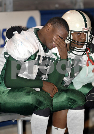 EHS starting quarterback, #5 Sophmore Diashaw Miller, who was out of the game in the 4th quarter due to an injury, is comforted by #63 Malcolm Frazaier, Junior. EHS vs LHS. Photo by Kathy Leistner