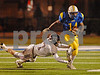 LHS Senior #14 Justin Fredricks runs by GC #77 Senior Thomas Mahoney.  Lawrence HS vs Garden City, November 16th, 2007. Nassau Conference II Championships. Hofstra Shuart Stadium. Photo by Kathy Leistne