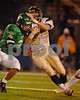BHS Senior#27 Brendan Bellew, Senior carries the ball #3 Tom Carlson, Senior Fdae.. Conference I Football Playoffs, November 17th, 2007, Hofstra Shuart Stadium, Baldwin vs Farmingdale. Photo by Kathy Leistner