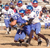 #25 for Gate City drags along Dan River defenders as he keeps gaining yardage. Photo by Ned Jilton II