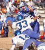 #33 for Dan River knocks the ball away from #25 of Gate City but the Blue Devils recovered the fumbled and scored on the next play. Photo by Ned Jilton II