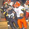 The Austin-East QB, #7, is flushed out of the back filed by the North defense and caught by #73. Photo by Ned JIlton II