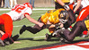 #75 for J.I. Burton struggles to hang onto the ball as he dives over for a touchdown. Photo by Ned Jilton II