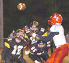 Sullivan North defenders pursue as ball flys out of hands of #2 for Knox Austin-East. Photo by Ned Jilton II