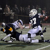 CARL RUSSO/Staff photo. St. John's Prep. defeated Andover 21-0 in Division One football playoff action Tuesday night. St. John's captain, Alexander Moore (27) and Conor Powers (bottom) break this pass up intended for Andover's Alex Marshall.  11/27/2012.