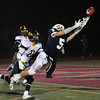 CARL RUSSO/Staff photo. St. John's Prep. defeated Andover 21-0 in Division One football playoff action Tuesday night. St. John's captain, Lucas Bavaro leaps as he attempts to catch this pass in the first-half while Andover's Andrew Deloury gives chase. The catch was unsuccessful. 11/27/2012.