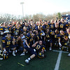 TIM JEAN/Staff photo. Andover football players celebrate on the field after they defeated Central Catholic High School 22-19. 11/22/12