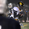 CARL RUSSO/Staff photo. St. John's Prep. defeated Andover 21-0 in Division One football playoff action Tuesday night. Andover's Chas Heseltine intercepts this pass in between two St. John's Prep.  players. 11/27/2012.