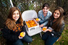 L-R Taylor Aloisio, Erin Sweeney, and Tess Leale 8th Graders in the Builders Club, pumpkin painting table. East Rockaway High School Homecoming, October 22nd, 2011. ERHS vs WT Clarke HS, 27-21. Photo by Kathy Leistner