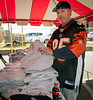 E. Rockaway resident  Rob Reill buys a ERHS sweatshirt. East Rockaway High School Homecoming, October 22nd, 2011. ERHS vs WT Clarke HS, 27-21. Photo by Kathy Leistner