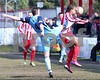 Luke Benbow takes one on the chin from City's Dave Theobald