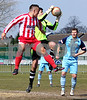 City keeper Zac Barrett gets the ball ahead of Ben Mackey