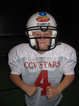 Travis Peterson receives Jersey #4 and teaches his teammates what its like to tackle someone on O-Line for the CCV Stars first official football season on the CCV campus in Peoria