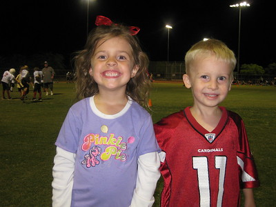 Matthew makes new friends while we sit and watch Travis at football practice.  Matthew is 4 and at this point a Cardinal's fan!