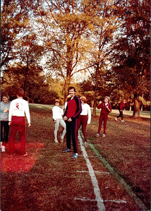 Looks like the Nov 1984 NCAA Regional at Furman University. That's Head Coach Gary Winckler (c) with Coach Al Schmidt (l). Visible team members are (l-r) Karen Parrish, Janie Regis, Brenda Moore, and Nancy Rettie.