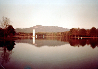 Furman Lake and bell tower and Paris Mountain. Or it's some other lake, tower, and hill.