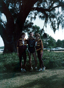 Brenda Moore, me, Janie Regis. Looks like the FSU golf course, where the cross country meets were held back then.