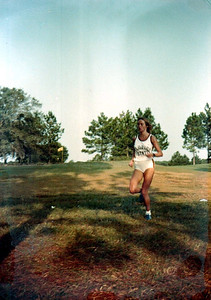 I'm thinking these were snapped at an FSU home meet at the FSU golf course. At any rate, it's Barbara Matthews running on some golf course with pine trees and oaks.