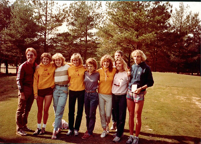 "Al Schmidt, Brenda Moore, Nancy Rettie, Barbara Matthews, Janie Regis, Sue Pockell, Karen Parrish, Carla Borovicka. Me peeking over the top. Check out the custom gold ""Lady Seminoles track & field"" pullovers the old man printed for 'em."