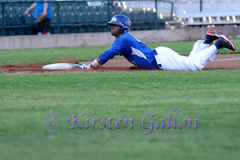 CJ Beatty slides into 3rd.
