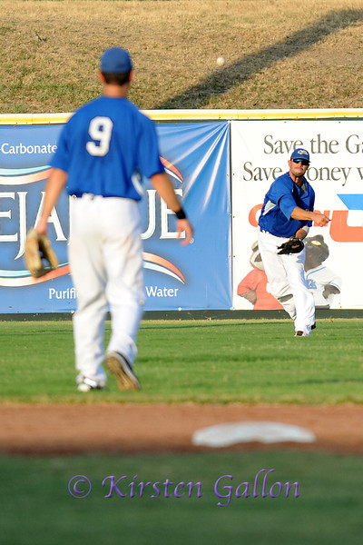 Chad Gabriel makes a throw to his cut-off, shortstop Shelby Ford