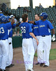 Cats teammates congratulate Jose Ruiz on his home run.