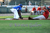 3rd baseman Brandon Jones has the ball and leans to make the tag out.