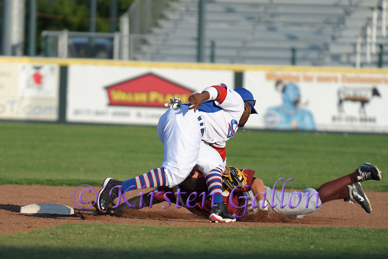 Even though the Abilene player was called safe, it appears in this photo that he was out.