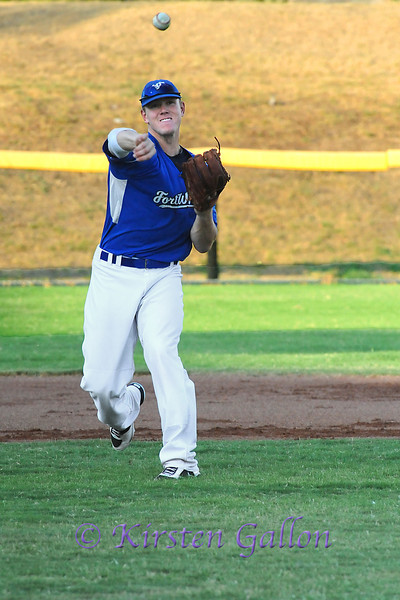 Shortstop Scott Dalrymple with a throw to first base.