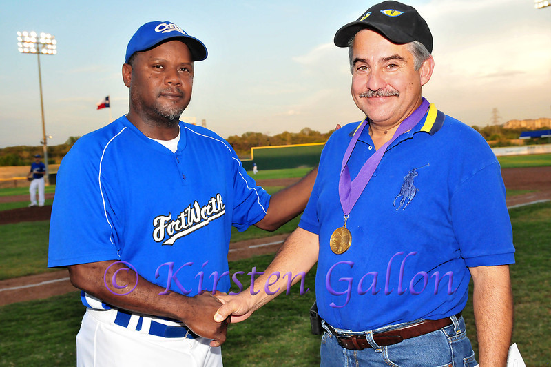 Manager Curtis Wilkerson giving out the Bayard H. Friedman HERO Award to local businessman and Cats fan, Art Cavazos.