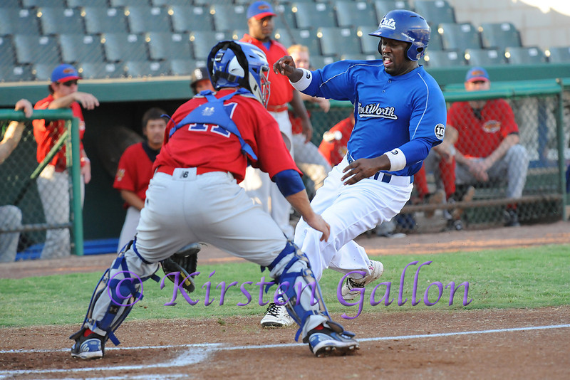 CJ Beatty as he gets ready to slide around the catcher for the first run of the game. 1st in a series of 3 images.
