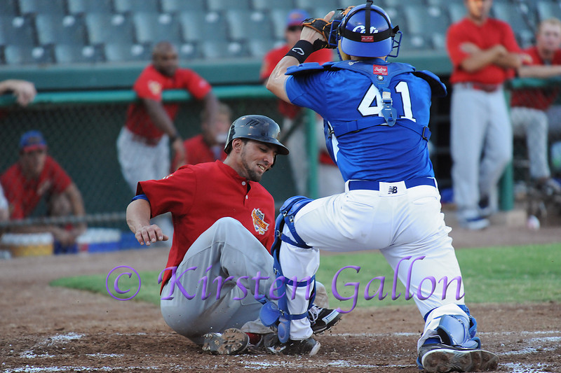 Catcher Derek Marshall gets a great throw from Chuck Caufield and makes the tag at home for an out.