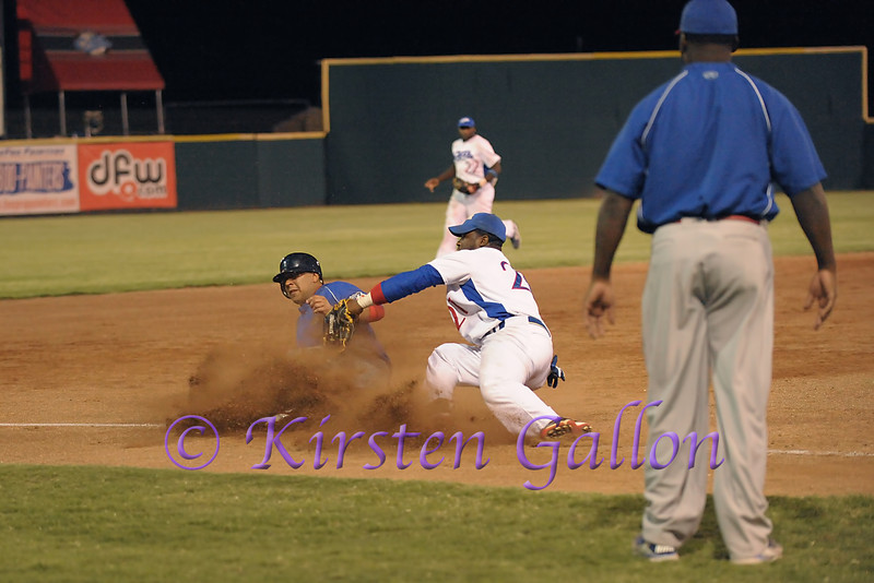 #21 C.J. Beatty tries to get the tag out at third base.