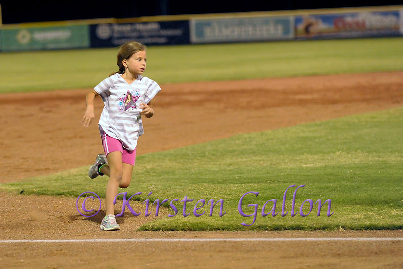 This little girl was the winner in the race against Dodger around the bases.
