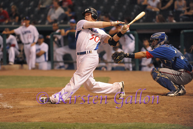 Scott Dalrymple with a powerful swing to get the offense going for the Cats.
