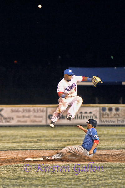 The ball goes sailing over 2nd baseman Antoin Gray's head as he makes a huge leap to try to catch it.  Photo #2 of this 2 shot series.