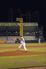 Brandon Wilkerson pitches with the night sky of downtown Fort Worth as his background.